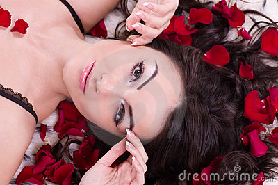 Girl with rose petal in hears