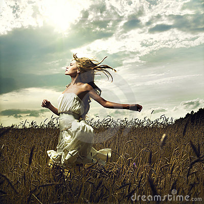 Free Girl Running Across Field Stock Image - 15800991