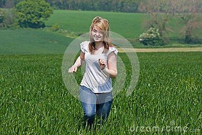 Girl running across a field
