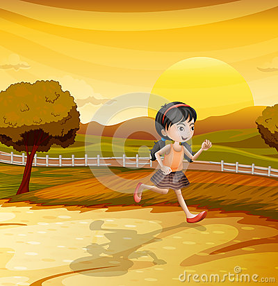 A girl running along the field