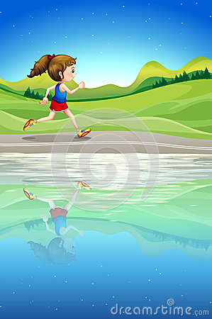 A girl running along the river
