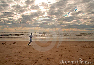 Girl running on a beach