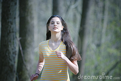 Girl Running in Forest