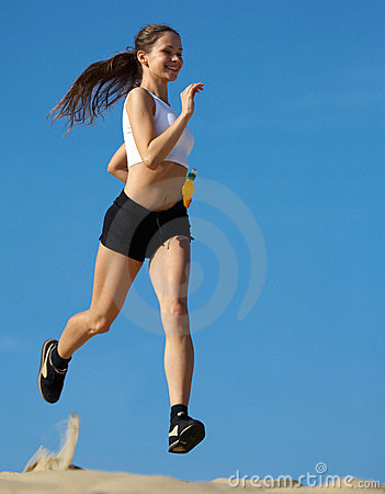 Free Girl Running On Sand Royalty Free Stock Photos - 5869348