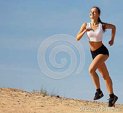 Free Girl Running On Sand Stock Photo - 5869350