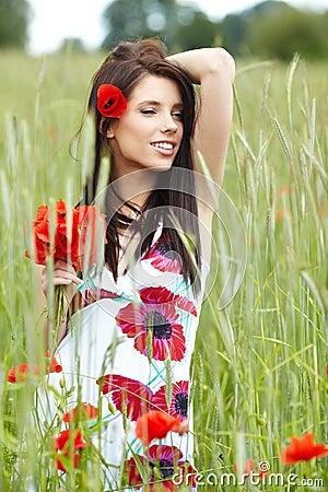 Girl running in poppy field