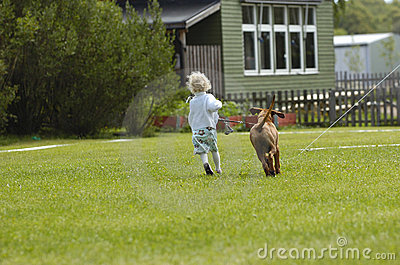 Girl running with puppy
