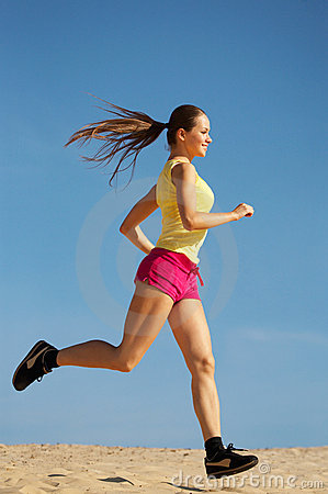 Girl running on sand