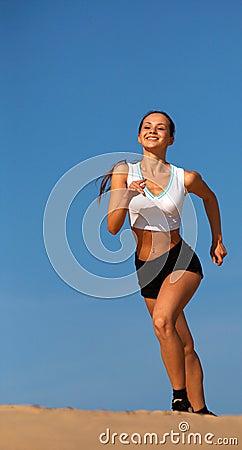 Girl running on sand