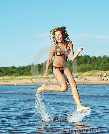 Girl running in the sea