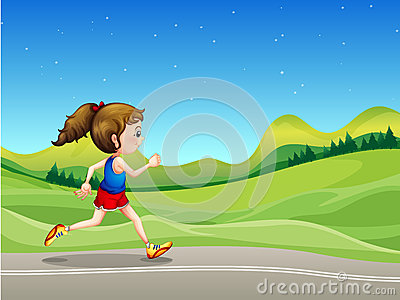 A girl running in the street near the hills