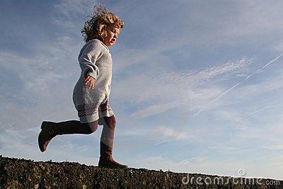 Girl running about to jump