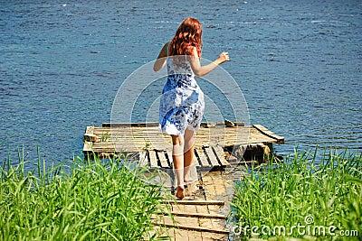 Girl running towards the river