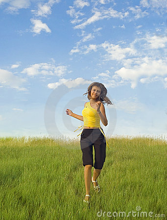 Girl runs across the grass