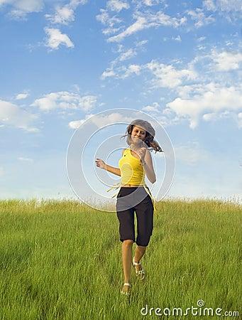 Girl runs across the grass
