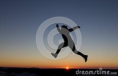 Girl runs in sunset