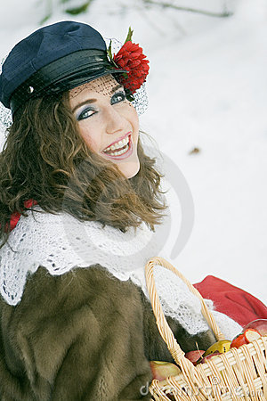 Girl in russian traditonal clothing for maslenitsa