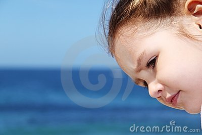 Girl s face with deep blue ocean backgroun