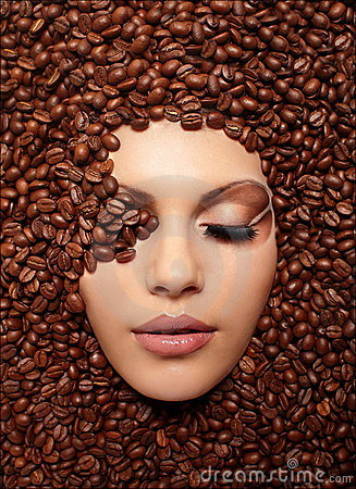 Girl s face drowned in coffee beans