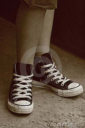 Girl s feet in converse sneakers