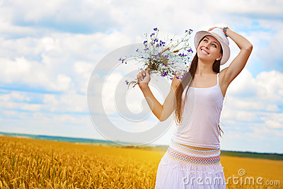 Girl s portrait  with wild flowers