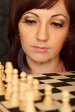 Girl with the sad looks on the chessboard.