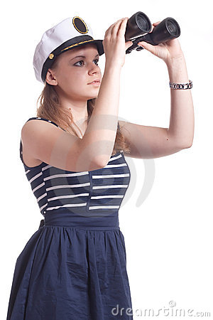 A girl in a sailor cap looks through binoculars