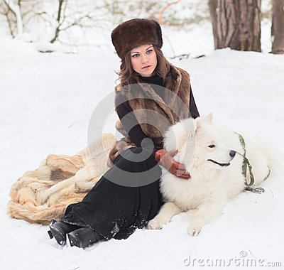 Girl with samoed dog