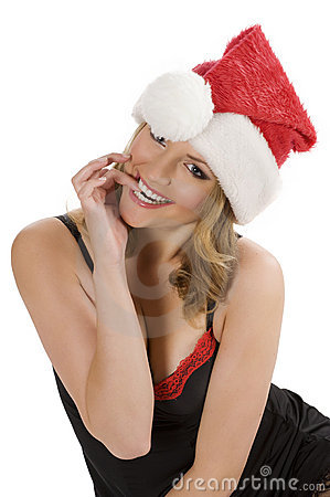 Girl in santa claus biting
