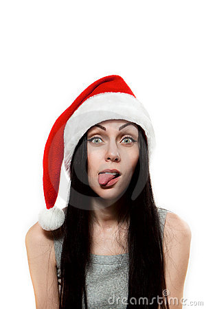 Girl in Santa Clause hat put out one s tongue