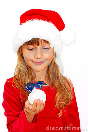 girl in santa cloth with christmas ball in hand