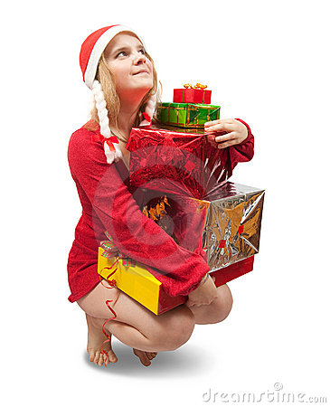 Girl in a santa hat with Christmas gifts