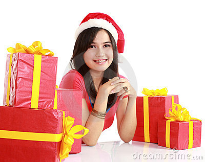 Girl in santa hat with christmas gifts
