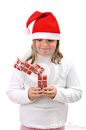 Girl in Santa hat with falling presents isolated