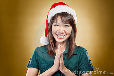 Girl with santa hat greeting