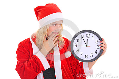 Girl with santa hat holding clock
