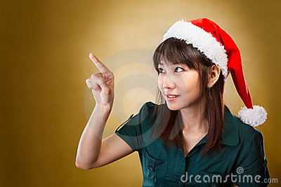 Girl with santa hat pointing away