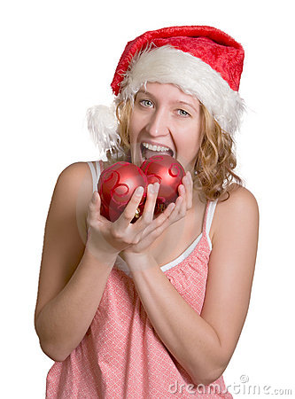 Girl in Santa hat  with red balls