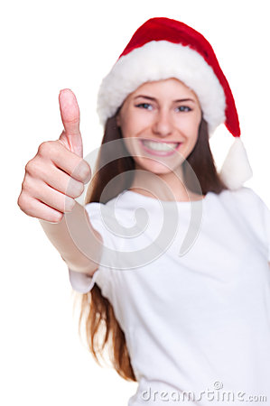 Girl in santa hat showing thumbs up