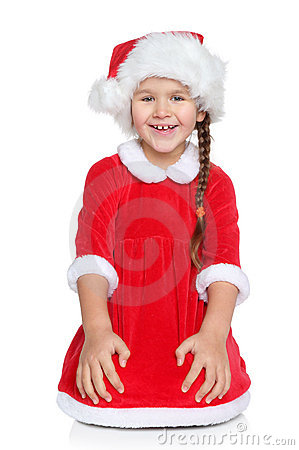 Girl in Santa hat sits on a white background