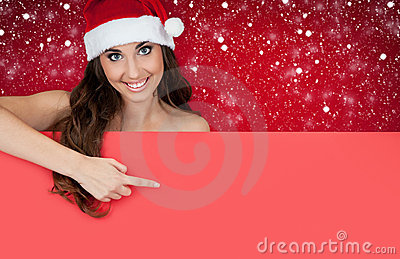 Girl with santa hat on snow showing on billboard