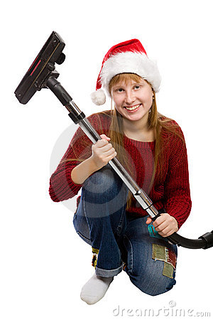 Girl in santa hat with vacuum cleaner