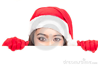 Girl in Santa peeking over sign board