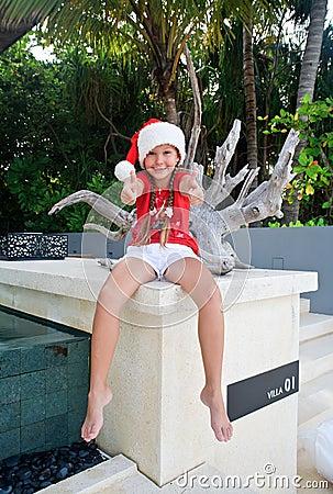 Girl in Santa s hat - OK sign
