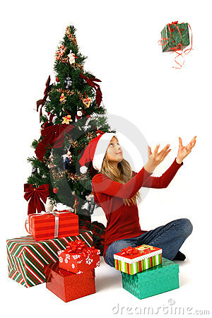 Girl sat by Christmas tree