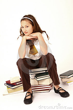 Girl sat on pile of books