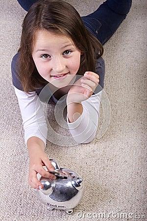 Girl saving her money