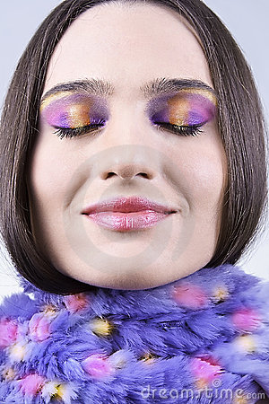 Girl in scarf with colorful makeup