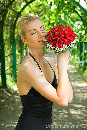 Girl scenting bouquet