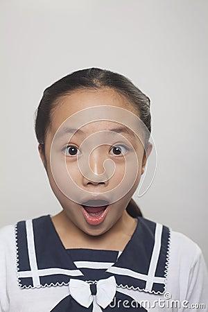 Girl in school uniform screaming, Studio shot